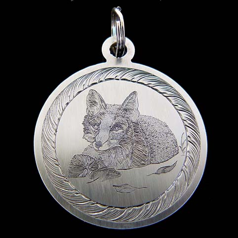 Resting Fox Engraved On A Stainless Pendant With Leaf Border