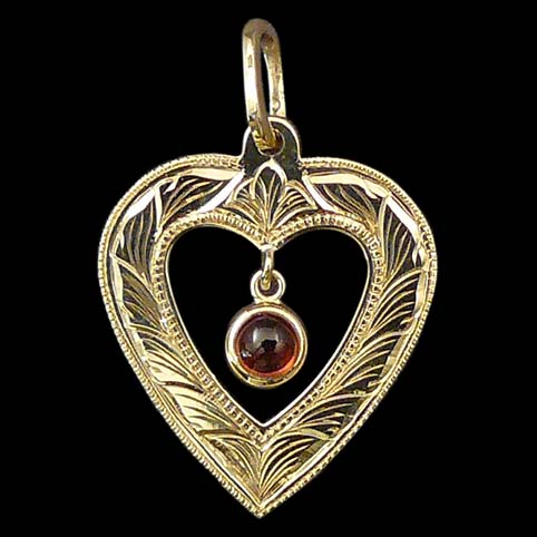 Dangling Mozambique Garnet In Gold Heart Pendant Engraved With Running Leaf Border
