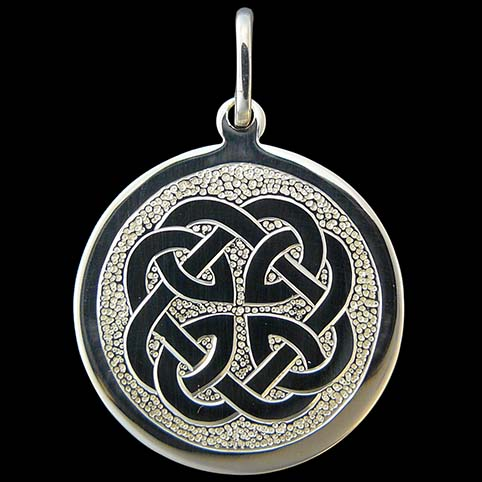 Sterling Silver Pendant Engraved With Celtic Knot Outlining A Cross In The Negative Space With Punch Dot Background
