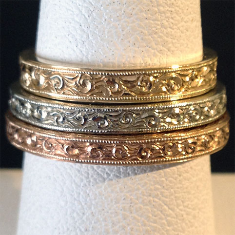 Three Gold Rings Engraved With Bright Cut Scroll Design