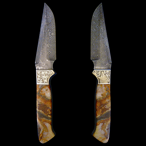 Damascus Steel Knife With Mexican Lace Jasper Handles And Engravings Of Coyote, Scroll, Leaf Border