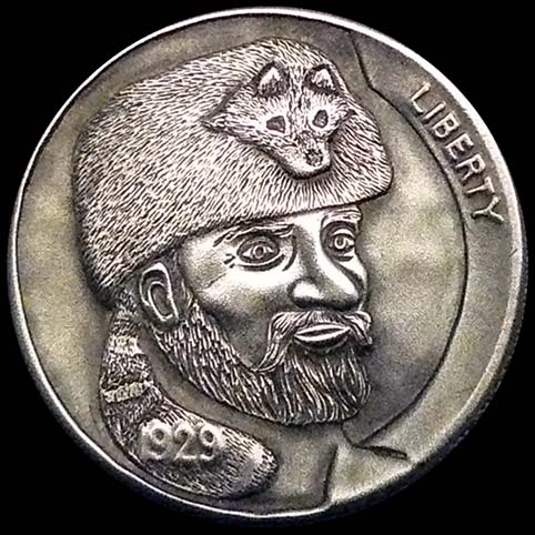 Hobo Nickel Engraved With Crockett, A Bearded Mountain Man Wearing a Coonskin Cap With Tail Wrapped Around Neck.