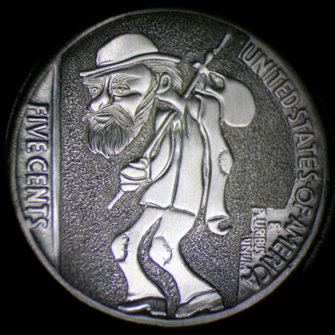 Hobo Nickel Engraved With A Walking Hobo With Beard, Hat, Patched Clothing, And Bindle Stick