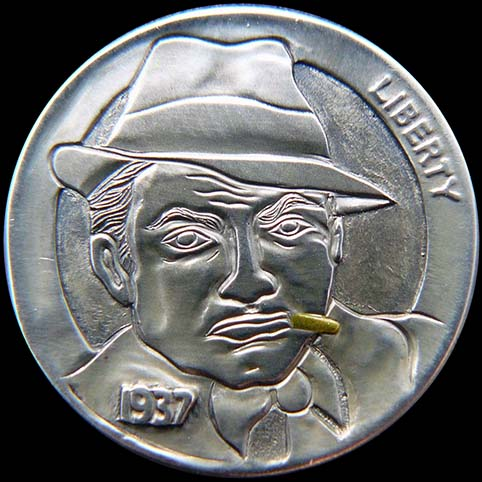 Little Caesar Is A Man Wearing A Hat While Smoking A Gold Cigar Engraved On A Coin