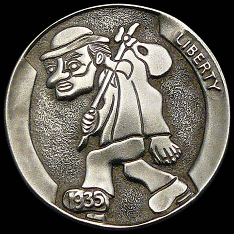 Hobo Nickel Engraved With A Walking Man Wearing A Hat With A Bindle Stick Slung Over One Shoulder.