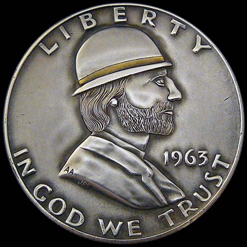 Franklin Half Dollar Engraved With A Bearded Ben Franklin, A Shoulder Length Haired Man Wearing A Bowler Hat With A 24 Karat Hat Band