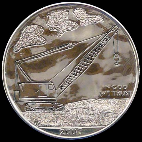 Geocache Coin Engraved With Crane (Obverse) And Jeep, License Plate, and Names (Reverse)
