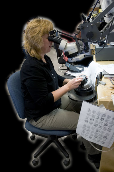 Picture Of Amy Working - Using Microscope To Engrave